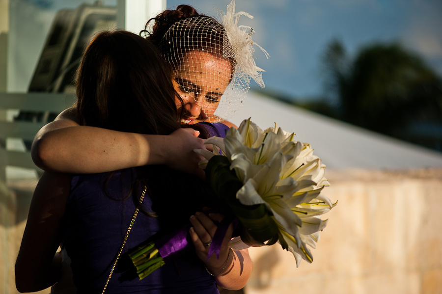 Bride hugs her Mom after ceremony at Azul Fives Wedding