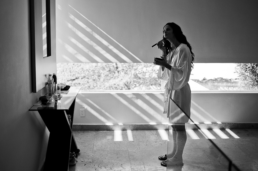 Bride putting make up on with beautiful light at Rosewood Mayakoba