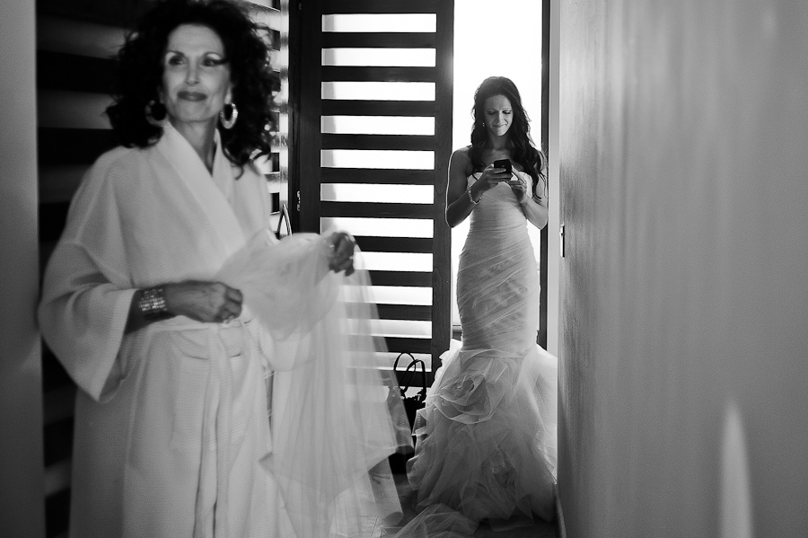 Bride getting ready texting her fiance in Mayakoba, Riviera Maya