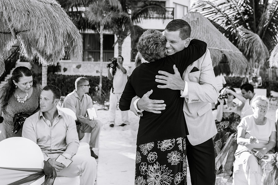Groom hugging mom Beach wedding SC Dreams Riviera Maya Mexico