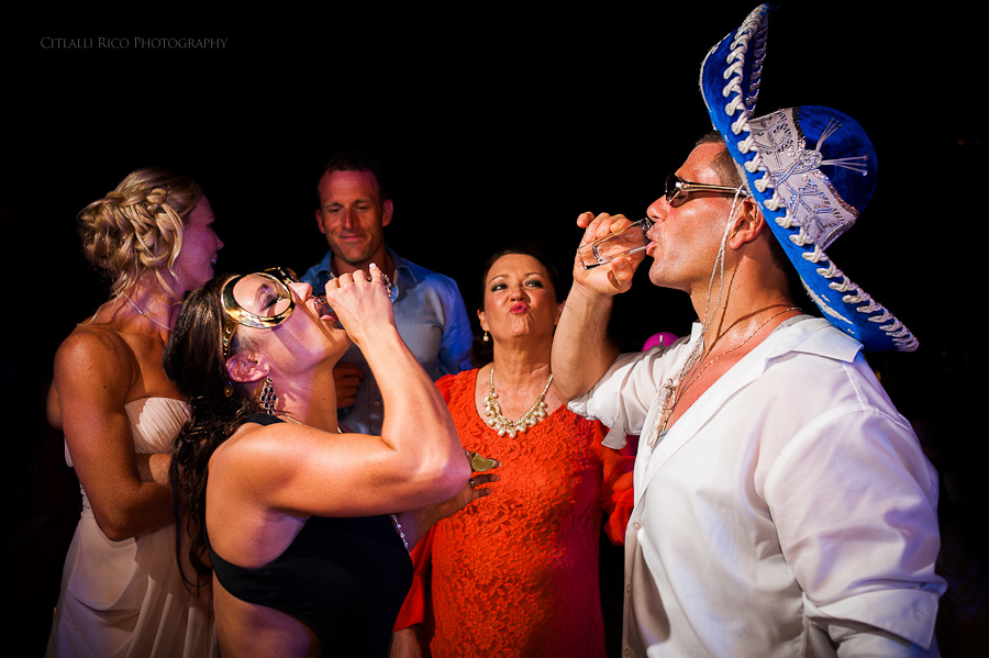Bride and groom doing tequila shots fun Beach wedding SC Dreams Riviera Maya Mexico