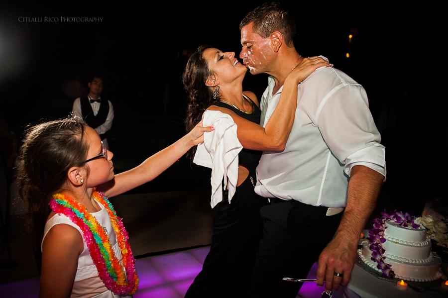 Bride and groom cake cutting funny Beach wedding SC Dreams Riviera Maya Mexico