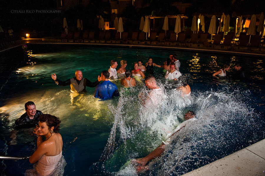 Guests diving in the pool fun Beach wedding SC Dreams Riviera Maya Mexico