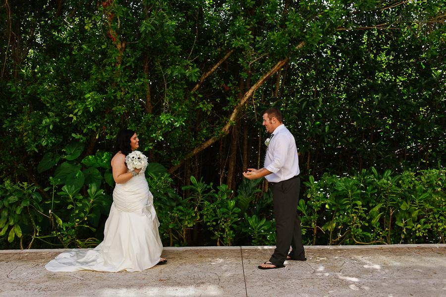 Bride and groom first look love Cancun mexico beach wedding SJ Bay Blue Grand