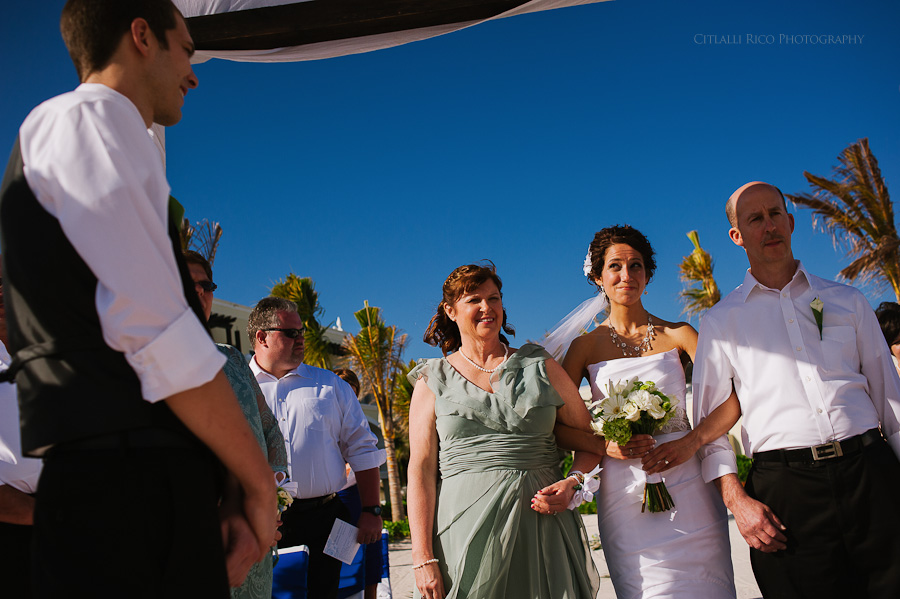 Bride and groom first look beach ceremony Wendy Adam Beach wedding Dreams Tulum