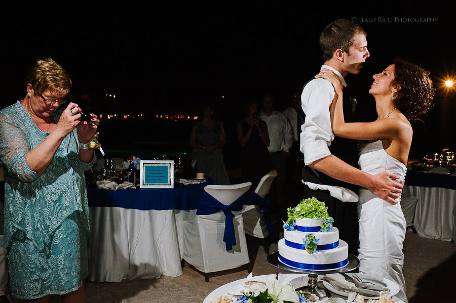 Bride and groom cake cutting fun Wendy Adam Beach wedding Dreams Tulum