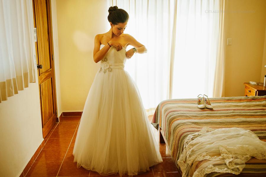 Bride getting ready fixing dress Lola y Bobby Ana Y Jose Tulum Mexico Wedding