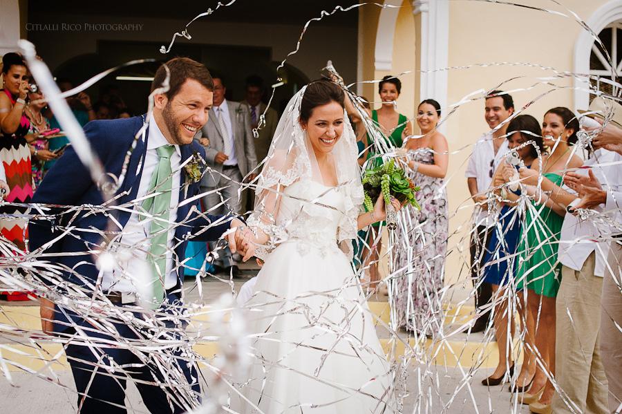 Bride and groom walking out Fun serpentines Lola y Bobby Ana Y Jose Tulum Mexico Wedding