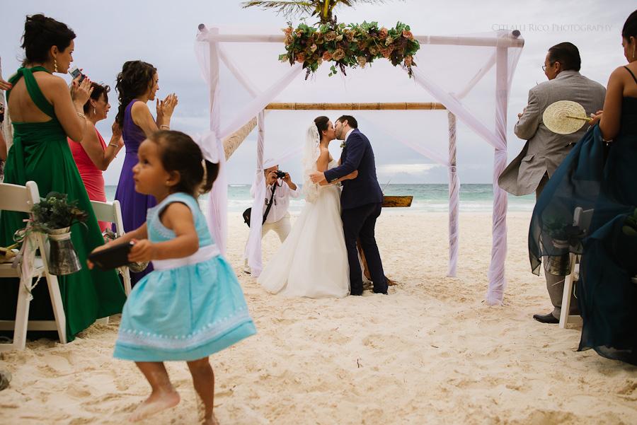 Bride and groom first kiss Beach ceremony Lola y Bobby Ana Y Jose Tulum Mexico Wedding