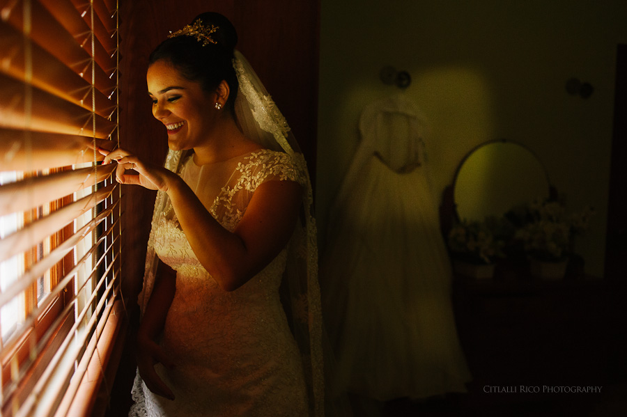 Bride sneaking out the window getting ready in Merida Wedding