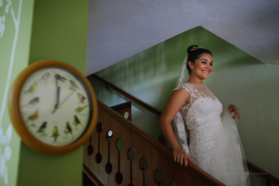 Bride walking down the stairs at home getting ready to leave