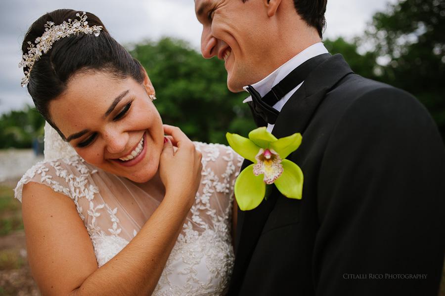 Bride and groom portrait laughing in Hacienda Hunxectaman