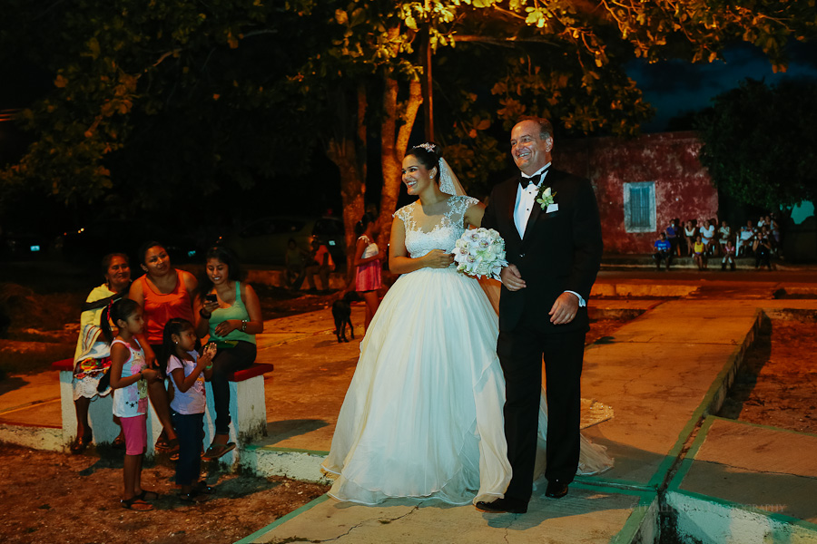 Bride and Father of the bride walking in Hacienda Hunxectaman Chapel