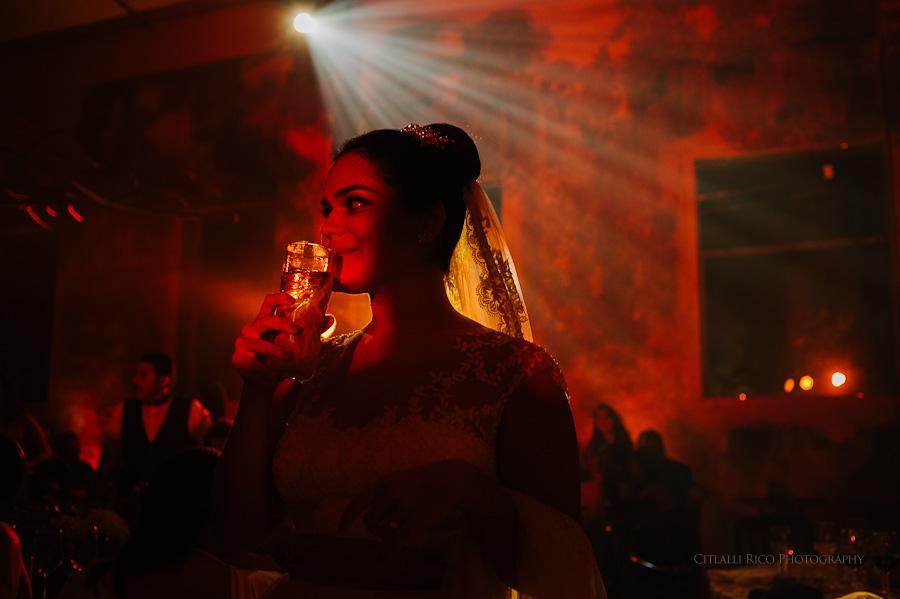 Red bride gorgeous reception light in Mexican Hacienda wedding