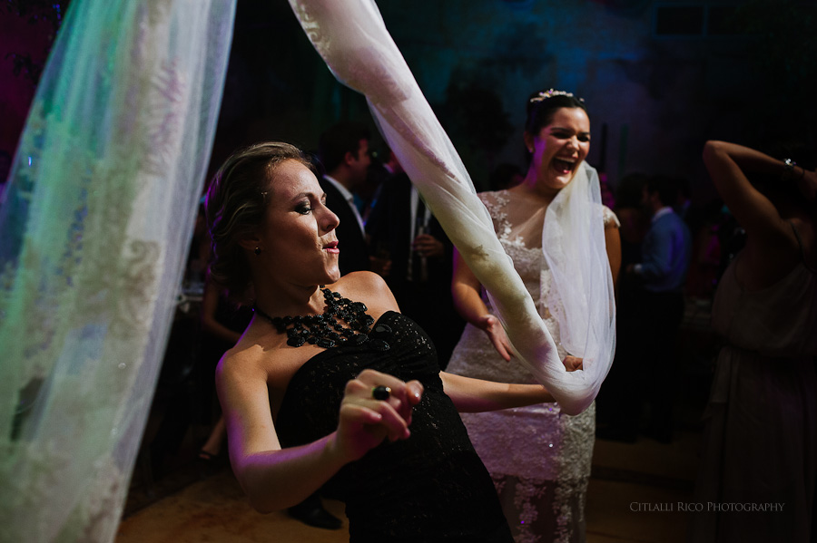 Bride using veil for wedding guests to dance La Conga