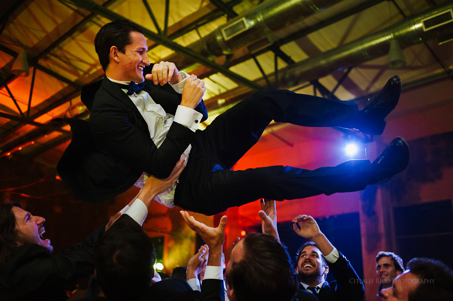 Flying groom toss Mexican wedding