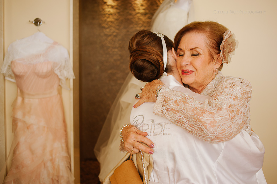 Bride getting ready emotional moment grandma Mers Axel Coral Beach Cancun Wedding