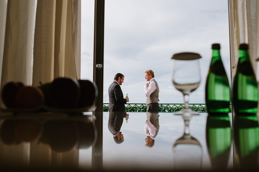 Groom getting ready reflection Mers Axel Coral Beach Cancun Wedding