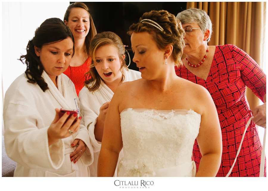 Bride getting ready with her bridesmaids watching a tutorial