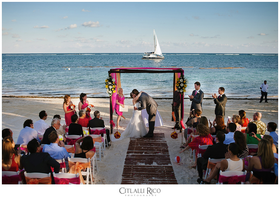First kiss during colorful ceremony on the beach