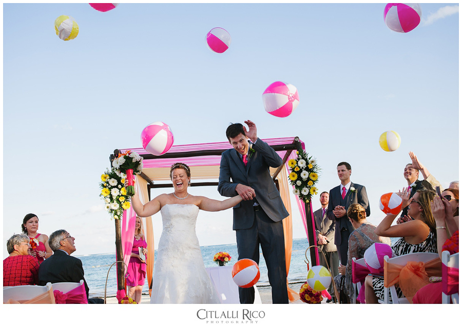 Fun idea with beach balls tosed at bride and groom walking down the aisle