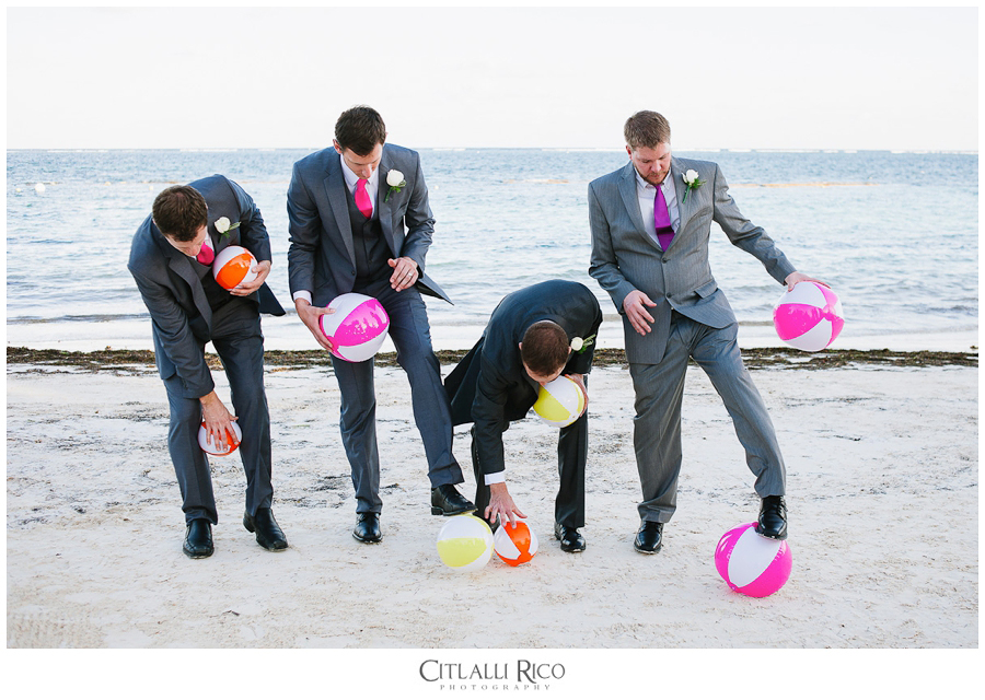 Groom and groomsmen playing with beach balls