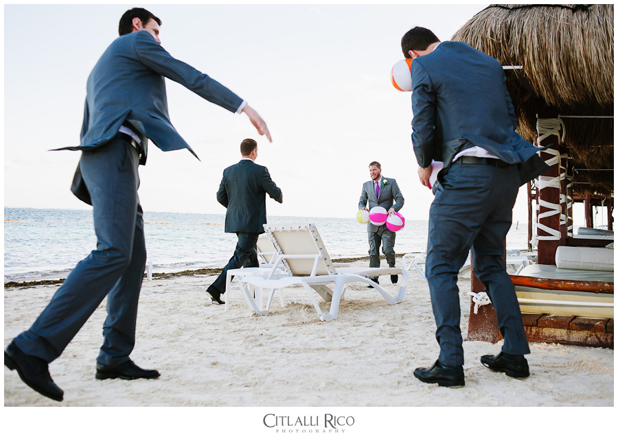 Groom and his brother playing with beach balls
