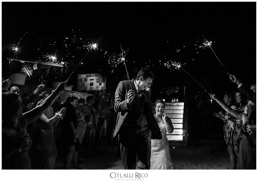 Guests holding sparklers for bride and groom funny photo
