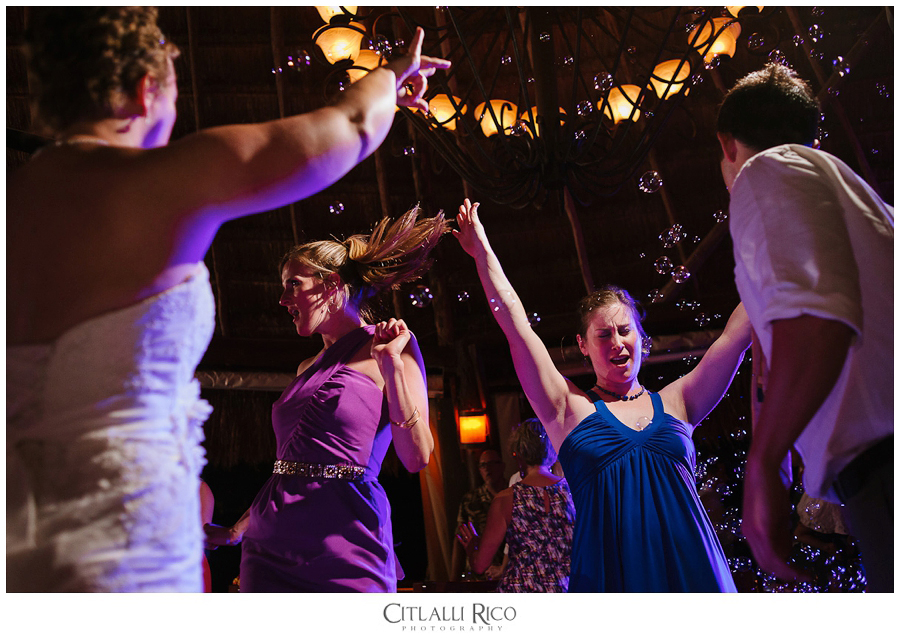 guests dancing at a wedding reception in Azul Beach in Puerto Morelos