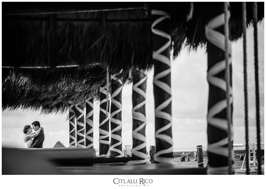 Azul Beach wedding portraits couple framed in palapa huts