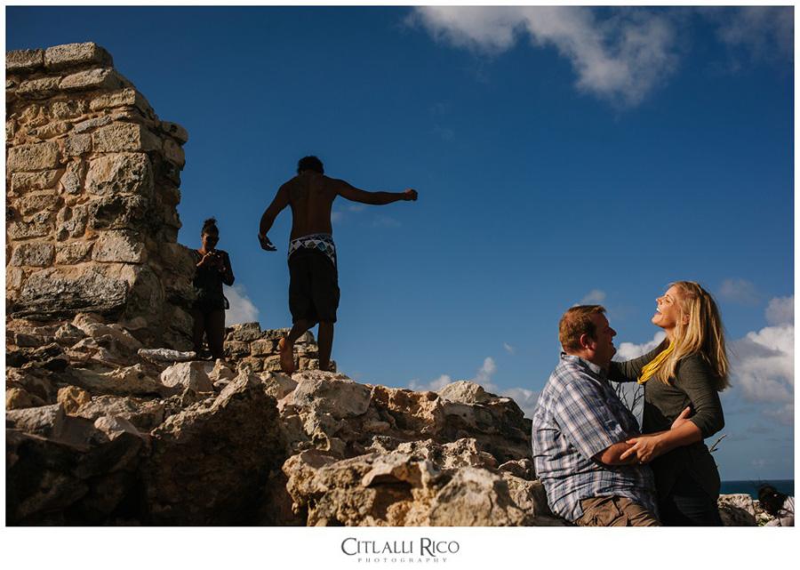 Bride and groom laughing by piramide Ixchel Sanctuary in Punta Sur