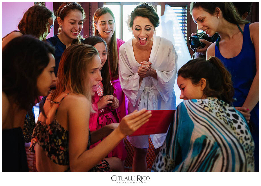 Bride having fun with bridesmaids at Fairmont Mayakoba Wedding Photographer