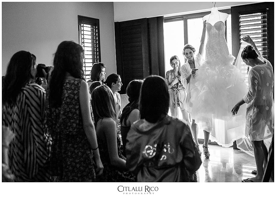 Bride getting ready about to put her dress on Xcaret Wedding Photographer