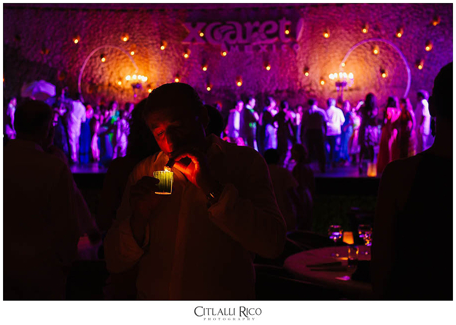 guest-lighting-up-Cigar-MJ-Xcaret-Wedding-028
