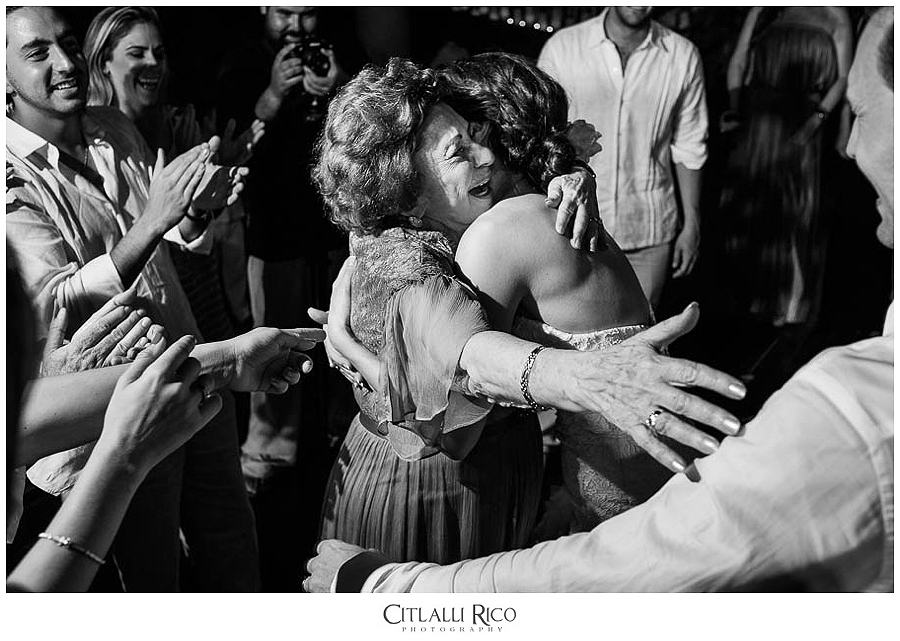Bride-hugging-family-emotional-MJ-Xcaret-Wedding-038