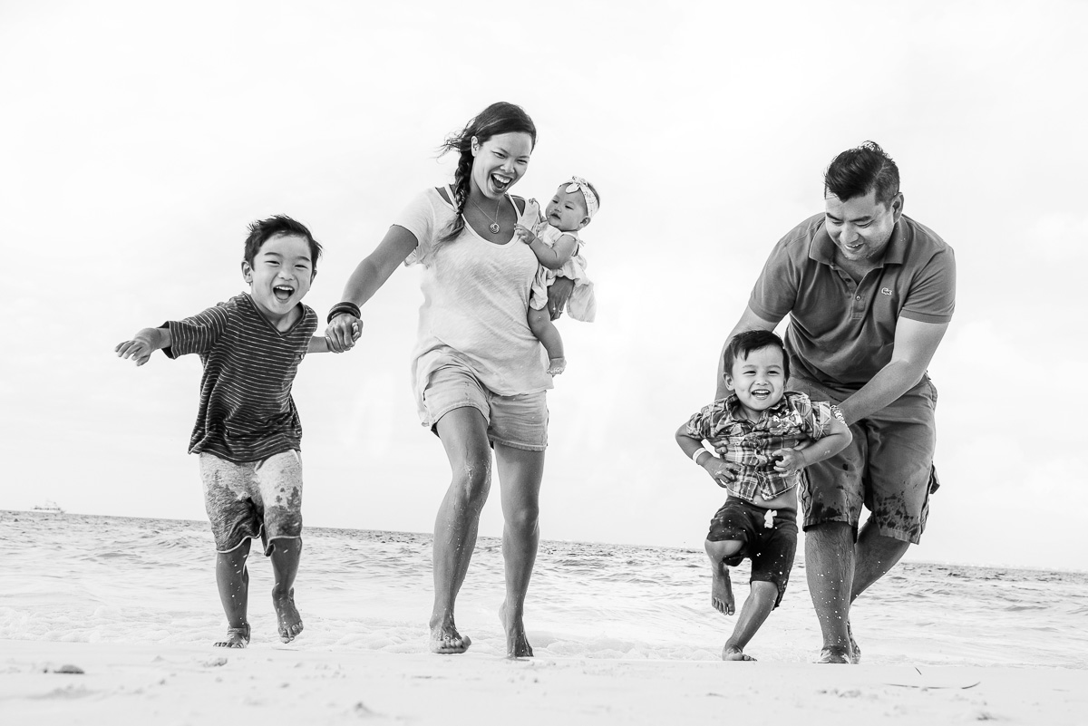 Family having fun on the beach during a photo shoot in Cancun
