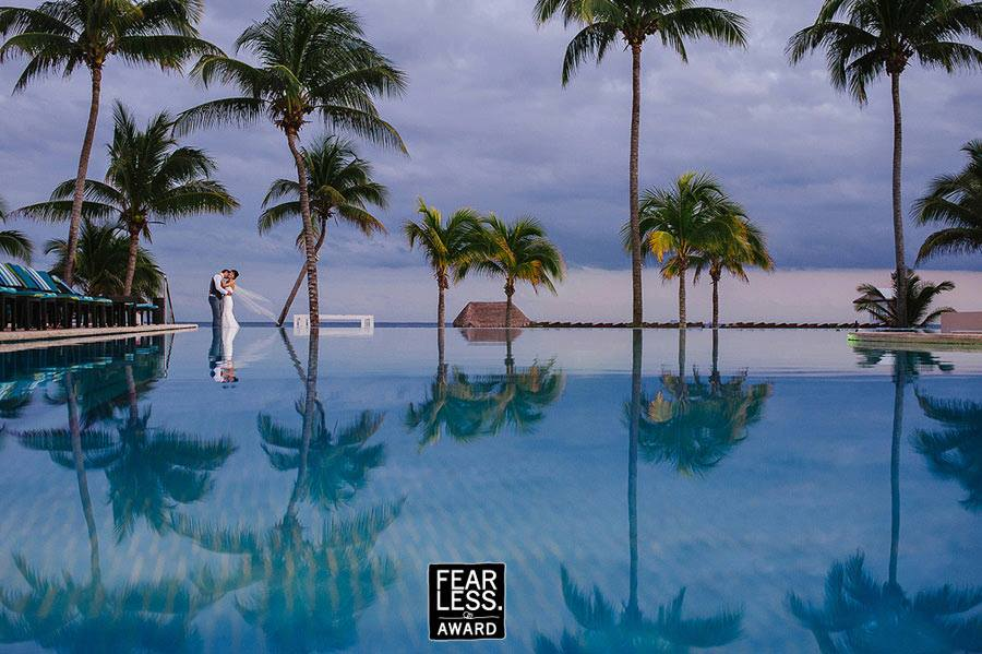 Fearless Awards Mexico bride and groom by the pool at Azul Fives Resort
