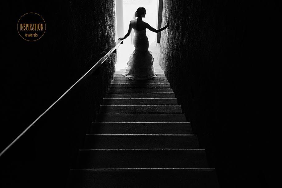 Bride by stairs in Isla Mujeres Casa de los Sueños venue award winning wedding photographer Mexico