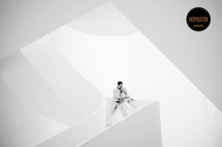 Bride and groom by stairs in Hotel Beloved Playa Mujeres award winning wedding photographer Mexico