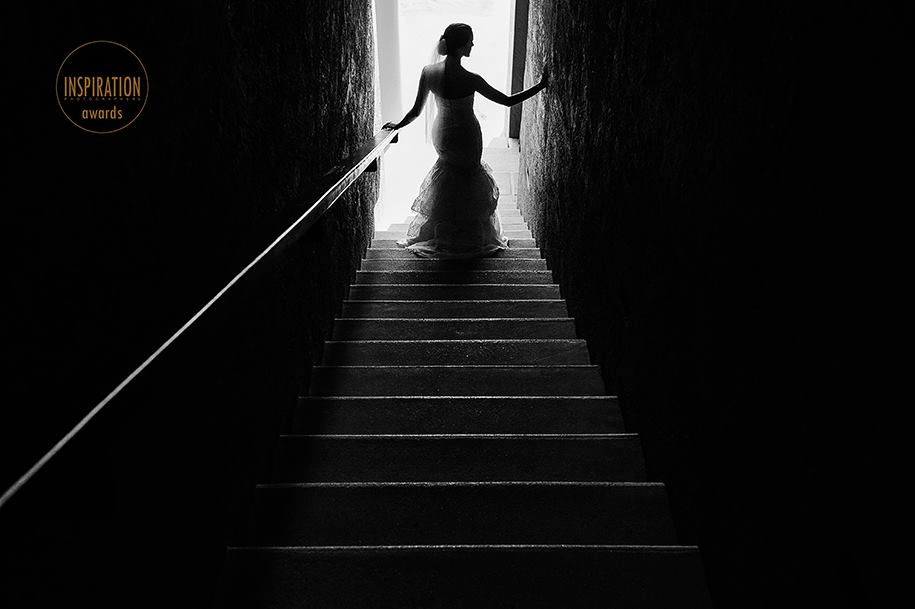 Bride on stairs getting ready for her wedding at Zama Beach in Isla Mujeres