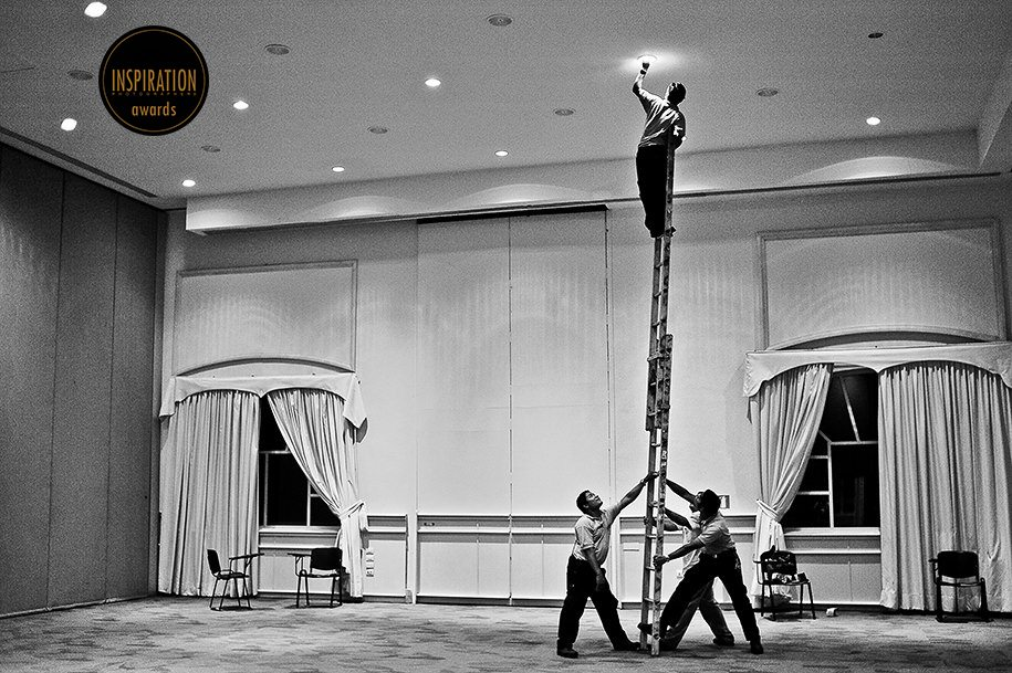 Excellence Playa Mujeres employees changing a light bulb for wedding reception