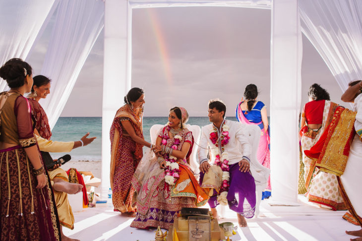 Hindu wedding ceremony at Barcelo Riviera Maya Mexico with rainbow in the back