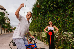 Dad to be on a bike waving in Playa del Carmen Session