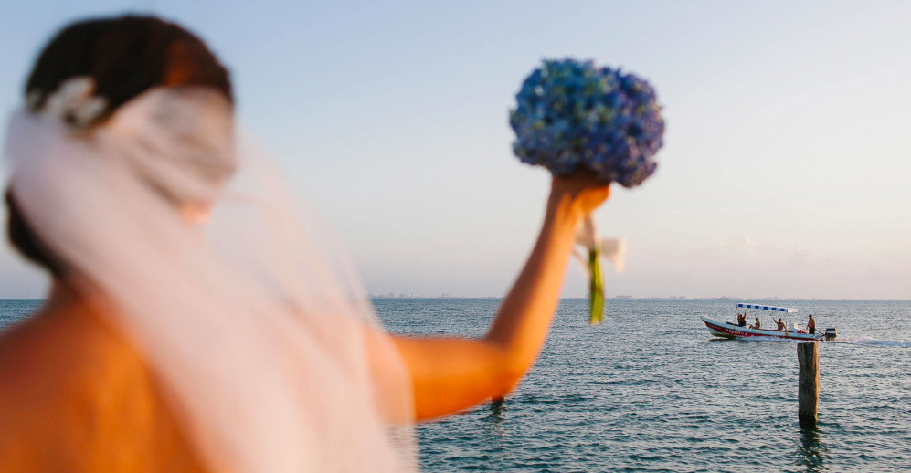 Bride waving to tourists from the pier in Isla Mujeres Zama Beach Wedding