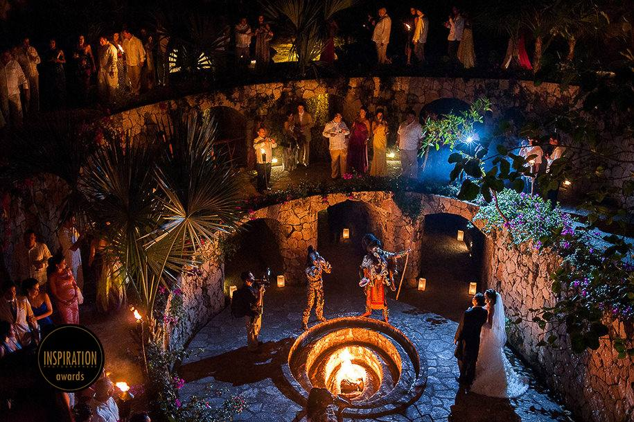 award winning wedding photographer Mexico Bride and groom at the Caracol in Xcaret Park