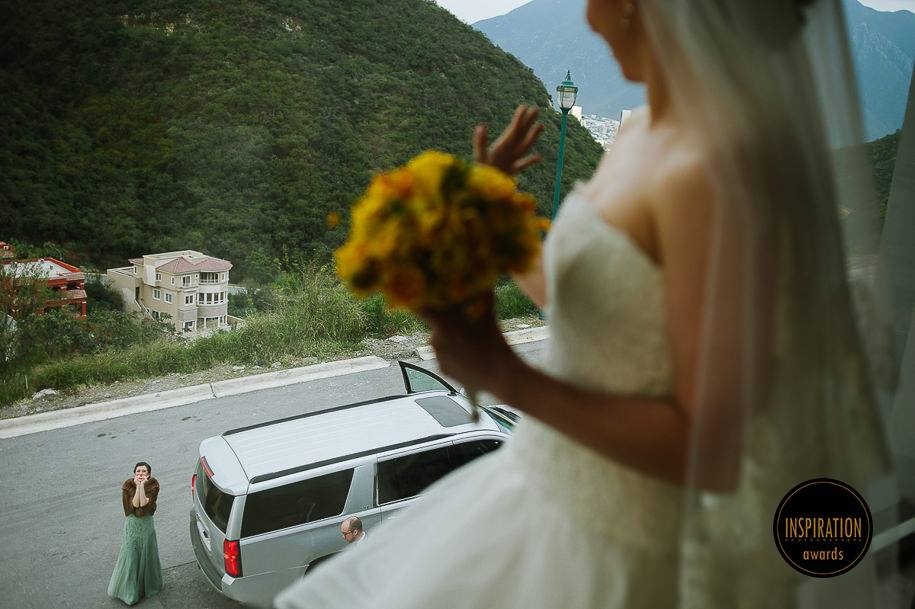 Bride looking through the window in Monterrey Wedding award winning wedding photographer Mexico