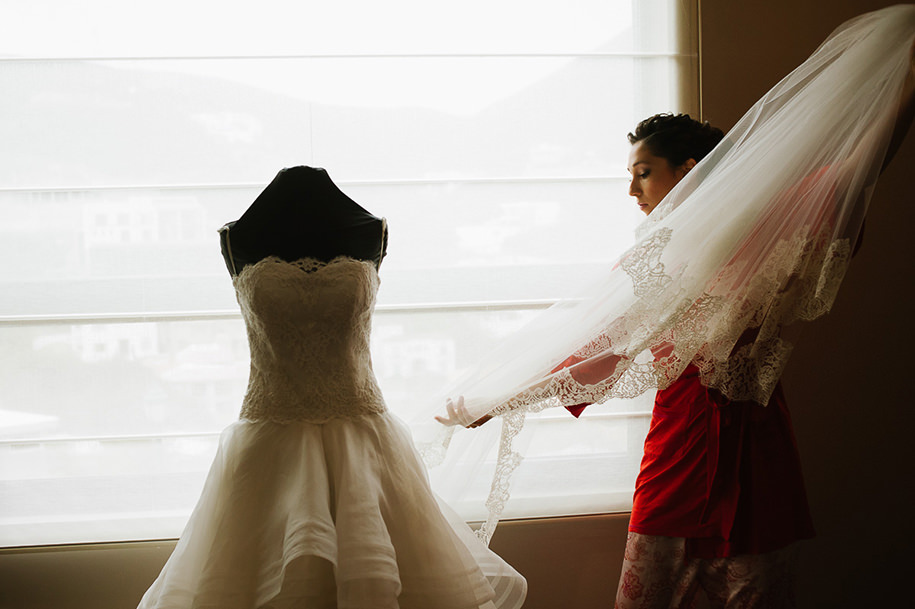 Bride grabbing her vdil before getting ready