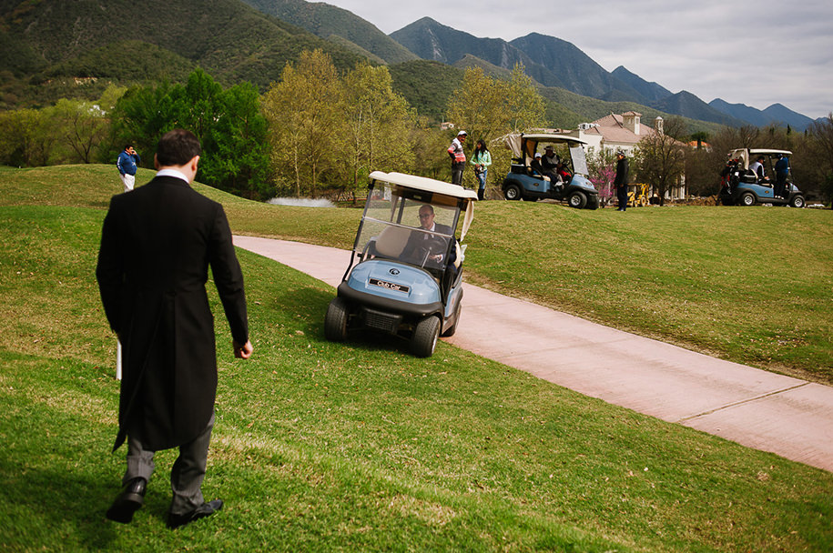 Groom and golf carts before ceremony