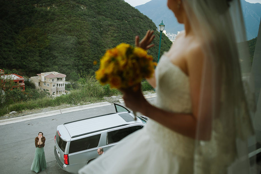Bride greeting family from the window