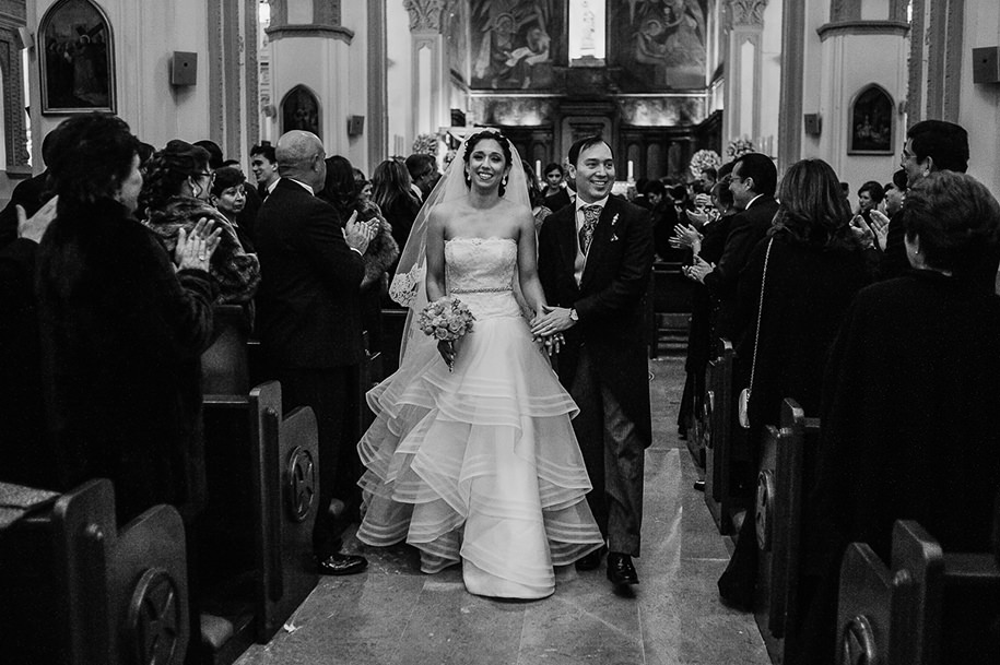Bride and groom walking down the aisle after their ceremony in Monterrey